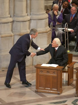 President George W. Bush shakes the hand of evangelist Billy Graham.
