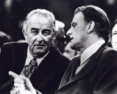 President Lyndon B. Johnson, left, chats with Billy Graham during the Greater Southwest Billy Graham Crusade in Irving, Texas in 1971. Religion News Service file photo