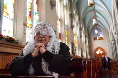 (RNS1-JAN26)  A woman named Rosario who didn't want to give her last name wears a lace veil while praying at a Catholic church in Cleveland. Prior to the Second Vatican Council, most women wore veils to Mass, but the reforms of the Council largely ended the practice. For use with RNS-VATICAN2-50, transmitted Jan. 26, 2009. Religion News Service photo by Lynn Ischay/The Plain Dealer.