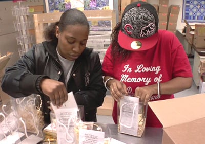 Members of the Soup of Success program in Elkhart County, Ind., learn job skills while packing gift baskets. A gift to Soup of Success, a food pantry and job training program run by the  faith-based Church Community Services agency in Elkhart, IN., would not be counted as religious giving before the new study. Religion News Service file photo