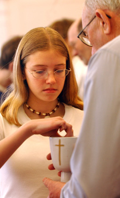 Some churches are modifying their worship practices, including a shared Communion chalice or hugs and handshakes at the sign of peace, in an effort to stem the spread of swine flu. Religion News Service file photo by Lynn Ischay.