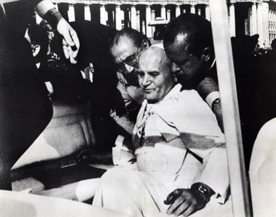 (RNS) Pope John Paul II falls in his popemobile after being shot in the abdomen by Turkish gunman Mehmet Ali Agca on May 13, 1981 in St. Peter's Square. RNS file photo