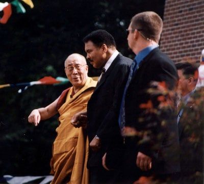 (RNS3-SEPT09) The Dalai Lama (left), spiritual leader of Tibet, speaks with former boxing  champion Muhammed Ali (center) at the dedication of an interfaith temple called the Chamtse Ling,  located on the grounds of the Tibetan Cultural Center in Bloomington, Ind., on Sept. 7, 2003. An  unidentified security guard looks on. See RNS-DALAI-LAMA, transmitted Sept. 8, 2003. Photo  by Dennis P. O'Connor.