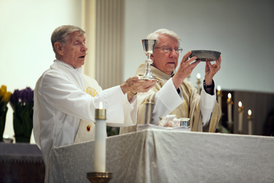 (RNS4-MAY18) Deacon Joe Krysiak, is shown here during Holy Communion at one of two parishes he runs, of St. Anthony of Padua Catholic Church in Baltimore. The Mass was celebrated by visiting priest the Rev. Roman Korzacheson. Deacons have a growing role in the Roman Catholic Church as there are less priests to go around. For use with RNS-CATHOLIC-DEACONS, transmitted May 18, 2010. Religion News Service photo by Dennis Drenner.