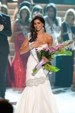 (RNS1-MAY19) Rima Fakih, 24, of Dearborn, Mich., reacts after being crowned Miss USA 2010  in Las Vegas, Nevada on May 16, 2010.  Fakih is Muslim, leading some to question whether her coronation is a sign of progress, or a violation of Islamic beliefs on modesty. For use with RNS-MUSLIM-MISSUSA, transmitted May 19, 2010. Religion News Service photo courtesy of Darren Decker/Miss Universe Organization.