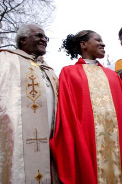 (RNS) The Most Rev. Desmond M. Tutu, former Archbishop of Cape Town, and Mpho A. Tutu, answer questions after the elder Tutu ordained his daughter an Episcopal priest at a 2004 ceremony in Alexandria, Va. RNS file photo by J.Carrier.