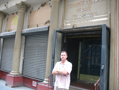 (RNS2-JUL26) Former New York City firefighter Tim Brown, in front of a shuttered Burlington Coat Factory store that is the site of a proposed 13-story Islamic cultural center near Ground Zero, has filed suit to stop the project. For use with RNS-GROUNDZERO-MOSQUE, transmitted July 26, 2010. RNS photo by Nicole Neroulias.
