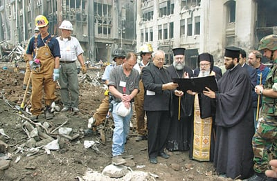 (RNS2-AUG23) Archbishop Demetrios of the Greek Orthodox Archdiocese of America, right (with gold vestments), leads a memorial service in 2001 at the site of the former St. Nicholas Greek Orthodox Church, which was destroyed by falling rubble from the World Trade Center during the 9/11 terrorist attacks. Attempts to rebuild the church have run into bureaucratic delays. For use with RNS-WTC-CHURCH, transmitted Aug. 23, 2010. RNS photo courtesy Dimitrios Panagos/Greek Orthodox Archdiocese of America.