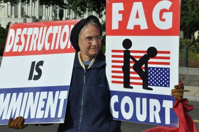 Protesters from Fred Phelps' Westboro Baptist Church in Topeka, Kansas rallied outside the U.S. Supreme Court as justices debated how far Phelps' free speech rights go. RNS photo by Jena Lowe
