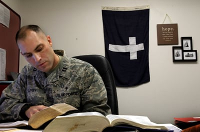 Air Force Capt. Mike Carey, a chaplain at Scott Air Force Base in Illinois, prepares his final Sunday sermon before deploying for Afghanistan. RNS photo by Robert Cohen/The St. Louis Post-Dispatch