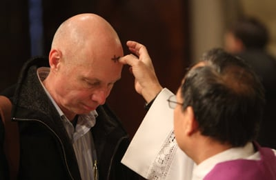 (RNS1-FEB28) A man receives ashes on Ash Wednesday at St. Patrick's Cathedral in New York in 2010. Christians are finding alternative ways to observe the 40-day period of fasting and abstinence that begins on Ash Wednesday. For use with RNS-ALTERNATE-LENT, transmitted Feb. 28, 2011. RNS photo by Gregory A. Shemitz.
