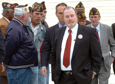 (RNS) Albert Snyder, center, is surrounded by veterans as he exits the Supreme Court after justices considered the limits of free speech surrounding an anti-gay church that picketed outside Snyder's son's military funeral. The court ruled March 2 for the picketers in an 8-1 decision. RNS file photo by Paul Kuehnel/York Daily Record/Sunday News.