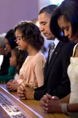 (RNS) President Obama and his family pray during Easter services at Allen Chapel AME Church in Washington on April 4, 2010. As many as four in 10 Americans cannot identify the president as a Christian. RNS file photo courtesy Pete Souza/The White House.