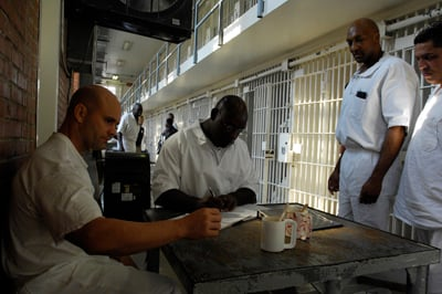 Prisoners in Sugar Land, Texas, celebrate 10 years, graduation and baptisms along with daily life in the a prison unit served by the InnerChange program developed by Christian ministry Prison Fellowship. Courtesy of Kevin Vandiver