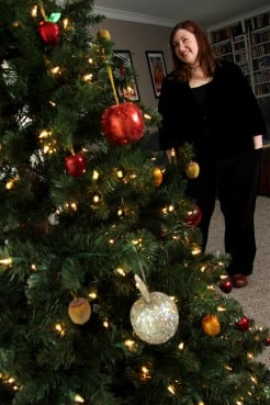 (RNS3-DEC16) Robin Zebrowski has acquired many apple ornaments over the years in honor of Sir Isaac Newton as she celebrates Newton's birthday on Dec. 25, 1642, or as she calls it, Newtonmas. For use with RNS-NEWTON-CHRISTMAS, transmitted Dec. 16, 2011. RNS photo by Amber Arnold.