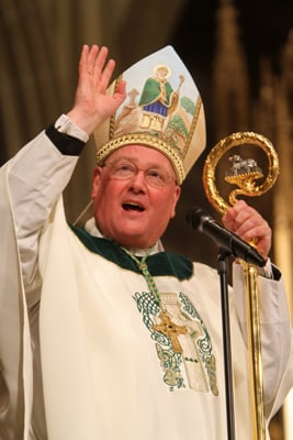 (RNS1-NOV16) New York Archbishop Timothy M. Dolan, president of the U.S. Conference of Catholic Bishops, shown here blessing the assembly at the end of a St. Patrick's Day Mass at St. Patrick's Cathedral in New York City, will be promoted to the College of Cardinals, the Vatican announced on Friday. RNS file photo by Gregory A. Shemitz.
