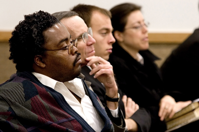 Malcolm Dickson, left, listens to testimonies during a Sunday service at the  Washington, D.C., Third Ward of the Church of Jesus Christ of Latter-day Saints.