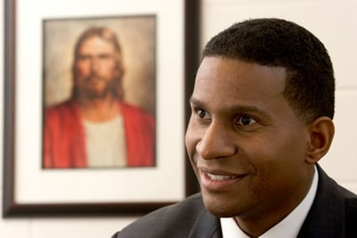 Bishop Al Jackson was elected the leader of the Kensington, Md., congregation of the Church of Jesus Christ of Latter-day Saints in 2005. Jackson is seated in his office in front of a picture of Jesus Christ. ``We're not trying to focus too much on just our differences or our skin colors but what we all have in common and that's the gospel,'' he said.