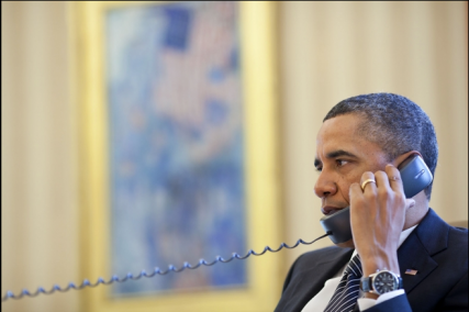 (RNS1-FEB13) President Barack Obama takes a phone call in the Oval Office.