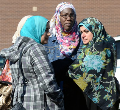 Supporters of Nevine Aly Elshiekh and alleged accomplice Shkumbin Sherifi, who are being held as suspects in an alleged behind-bars plot to kill a witness in a terrorism trial, gather outside a courthouse in Wilmington, N.C.