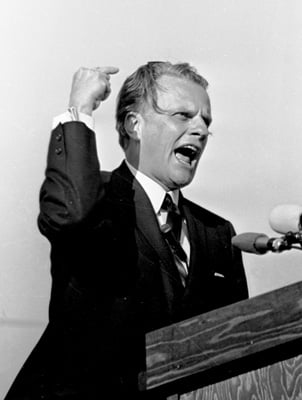 Billy Graham speaks at Legion Field in Birmingham, Ala., in 1964. Religion News Service file photo