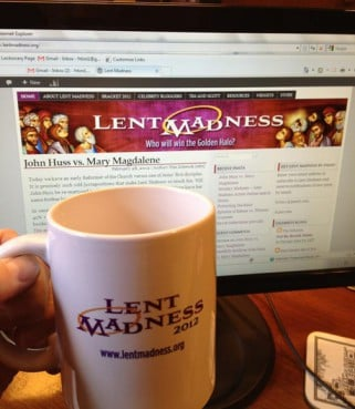 Fr. Tim Schenck, creator of Lent Madness, models the new collector item mug with the Lent Madness 2012 website in the background.