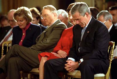 President Bush and wife Laura bow their heads along with National Day of Prayer Chairwoman Shirley Dobson and her husband, religious broadcaster James Dobson, at a May 2003 ceremony in the East Room of the White House. President Obama has said he will appeal a federal judge's ruling that the law creating the National Day of Prayer is unconstitutional, even though he declined to host a Bush-style observance at the White House.