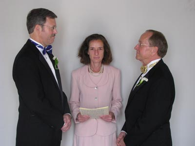 Episcopal Bishop V. Gene Robinson, right, entered a New Hampshire civil union with his longtime partner, Mark Andrew, left, at St. Paul's Episcopal Church in Concord, N.H. At center is Justice of the Peace Ronna Wise.
