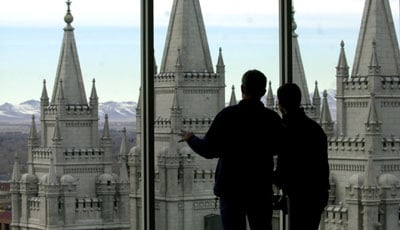 Michael Patrick and Eduardo Martins, both members of the Church of Jesus  Christ of Latter-day Saints, observe Temple Square from an observation deck in Salt Lake City,