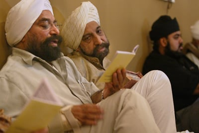 Jas Singh of New York City, left, and Gurbakht Singh Gulati of Toronto, right,  attend worship at the Gobind Sadan Temple in Palermo, N.Y.