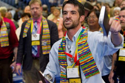 The Rev. Will Green helps lead a protest calling for greater inclusiveness in the United Methodist Church on the floor of the 2012 United Methodist General Conference in Tampa, Fla.