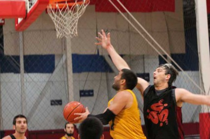 Zeeshan Hyder with the up and under layup during a Muslim Basketball League game in Southern California.