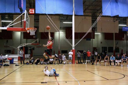 Abdul Yousef dunking over his brother, Yaser Yousef, during the dunk contest with the Muslim Basketball League in Southern California.