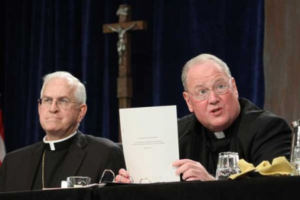 New York Cardinal Timothy M. Dolan, president of the U.S. Conference of Catholic Bishops, addresses the bishops at their annual mid-year meeting June 13, 2012 in Atlanta. At left is Archbishop Joseph E. Kurtz of Louisville, Ky., vice president of the conference.