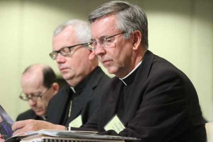 U.S. bishops gather for their annual mid-year meeting June 13 in Atlanta. Pictured from right are Bishop Peter F. Christensen of Superior, Wis.; Auxiliary Bishop Donald J. Hying of Milwaukee; and Bishop Thomas J. Olmsted of Phoenix.