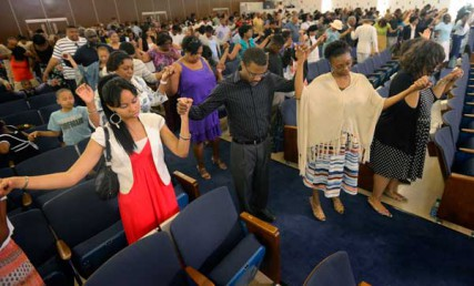 Congregants pray at Colonial Baptist Church in Randallstown, Maryland, on Sunday, June 10, 2012.