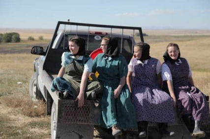 King Colony, Montana: Young Hutterite women (Claudia Hofer, Kristy Hofer, Tammy Hofer, and Marie Hofer) ride on the back of a truck.