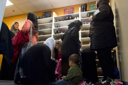 Sakinah Smith, left, visits with others in the women's area of Masjed As-Saber mosque following a Friday service. It is Islamic custom to removes shoes before entering a mosque to pray. Portland, Ore.'s largest mosque, the Islamic Center of Portland, Masjed As-Saber, draws worshipers from all corners of the world as well as from the US. Many who pray there talk of a worsening political climate rooted in misunderstandings of Islam.