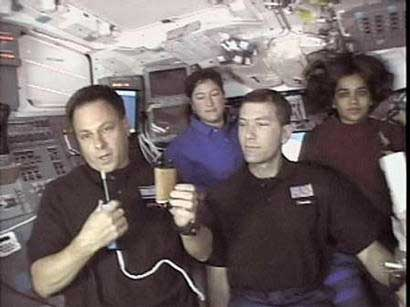 Israeli Astronaut Ilan Ramon holds a small Torah scroll in space from the Holocaust, as Astronauts Laurel Clark, Rick Husband, and Kalpana Chawla look on. On board the Columbia is a crew of seven – six Americans and Ramon, Israel's first astronaut and the son of a survivor of Auschwitz. Also aboard, in Ramon's care, is this Torah, given to him by another Holocaust survivor.