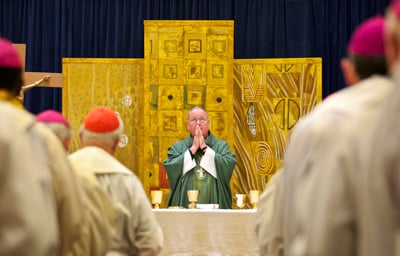 Archbishop Timothy Dolan of New York, president of the U.S. Conference of Catholic Bishops, celebrates Mass for other bishops at their summer meeting in Bellevue, Wash.