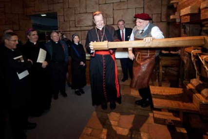 Cardinal Giovanni Lajolo, former president of the Governorate of Vatican City State and of the Pontifical Commission for Vatican City State, tries his hand at a life-size replica of the Gutenberg printing press. The 15th-century invention featuring movable type democratized learning and printed the famous 1455 Gutenberg Bible, a noble fragment of which is on display in Verbum Domini.