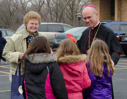 Bishop Kevin Rhoades of Fort Wayne-South Bend, Indiana and Sister Kathleen Kneuven speak with students in the parking lot of St. Jude Catholic Church in Fort Wayne. Bishop Rhoades is chairman of the Committee on Laity, Marriage, Family Life and Youth of the U.S. Conference of Catholic Bishops, which is sponsoring Natural Family Planning Awareness Week.