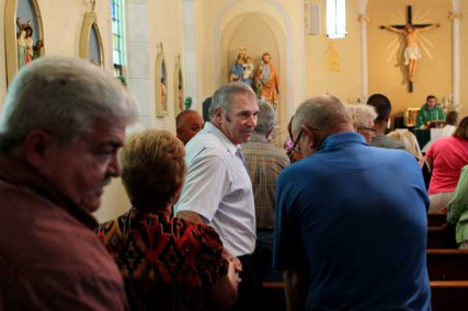 Joseph Haegele greets other church members at St. Gertrude Parish in Grantfork, Ill., on Sunday, July 15, 2012.