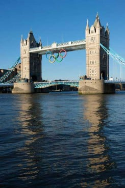 London, United Kingdom - June, 28th 2012: Olympic rings adorn Tower Bridge on a sunny evening. Originally lowered into place on June 27th 2012 to mark one month before the start of the London 2012 Olympic Games.