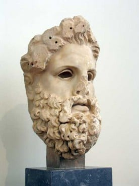 Head from a colossal marble cult statue of Zeus, which was found at Aigeira, Achaia. Pausanias tells us (in the 2nd century BC) that the statue was carved by the Athenian sculptor Eukleides, who was active in the second half of the 2nd century BC. The eyes were originally made of a different material and inlaid into the marble.