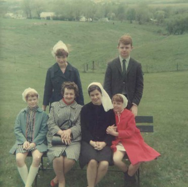 Sister Pat Farrell (seated center right) as a senior novice during a family visit in 1967.