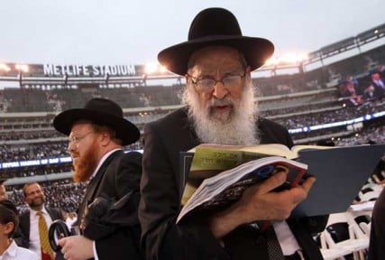 Nearly 100,000 Jews stand to pray as the Mincha begins at MetLife Stadium Wednesday August 1, 2012, during the 12th Siyum HaShas celebration. Everyone will celebrate their completion of the Talmud, a record of Jewish law. Many attending have red one page a day for the past seven and a half years.
