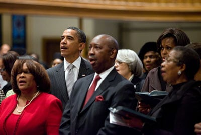 President Barack Obama, First Lady Michelle Obama, and daughters Sasha and Malia (hidden behind other parishioners) attend services at Metropolitan African Methodist Episcopal Church in Washington, D.C., Sunday, Jan. 16, 2011.