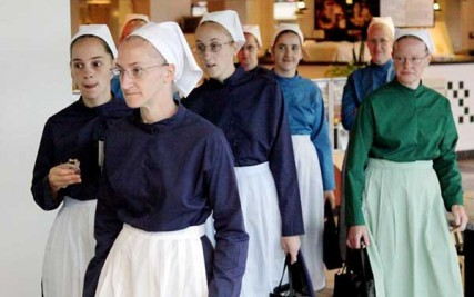 Amish women enter the federal courthouse in Cleveland for the beginning of the trial of 16 Amish defendants -- 10 men with full beards, six women in white bonnets -- who are on trial on charges related to a series of beard- and hair-cutting attacks against fellow Amish men and women last year.