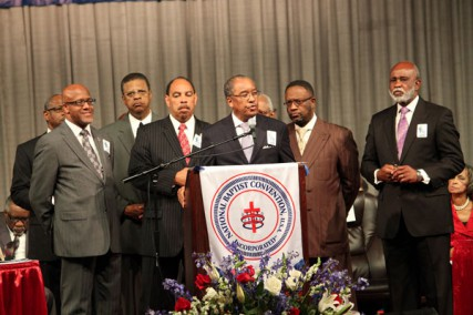 Rev. Julius Scruggs (center), president of the National Baptist Convention, USA, is surrounded by other Baptist leaders and NAACP officials on Wednesday Sept. 5 in Atlanta.